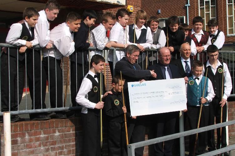 Ian Thompson (Devon Community Foundation) presenting a cheque for £6,947 to WEBSF Champion Roger Cole and Head of Coaching Steve Canniford, surrounded by some of the youth that will benefit from this grant